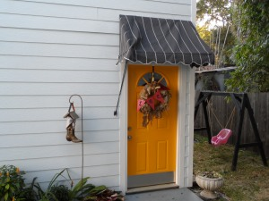 The door to the garage apartment is yellow.