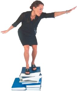 woman on stack of books uid 3