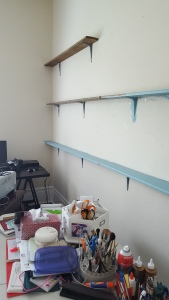 So here I've painted my shelves. These were floor baseboards in this 100 year-old-house.