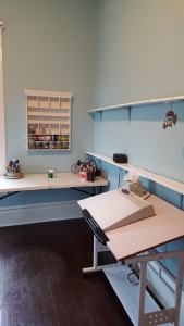 Now before, the walls were cream and the shelves blue, now the walls are blue and the shelves white. I like this better.